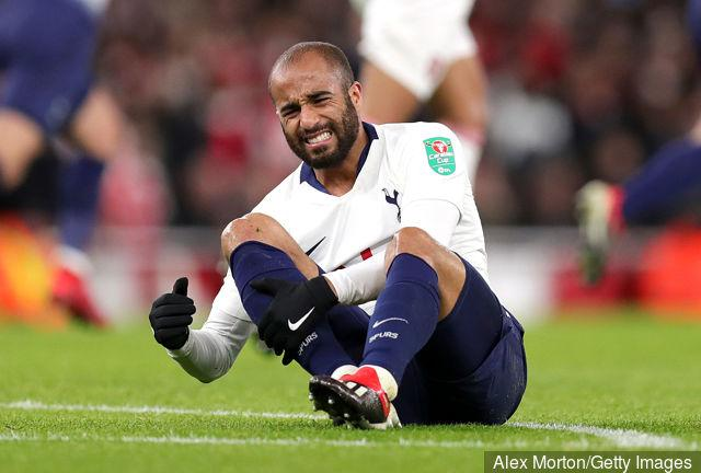 lucas_moura_of_tottenham_hotspur_reacts_holding_his_leg_during